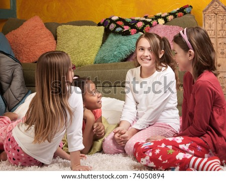 Four excited little girls together for a sleepover party - stock photo