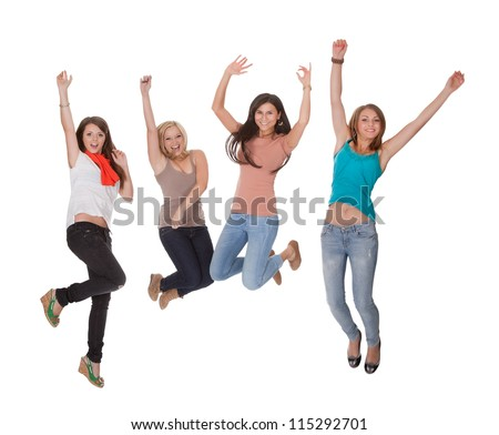 Four excited young woman jumping for joy with their hands raised in the air in celebration isolated on white - stock photo