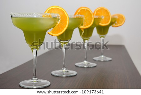 Four exotic drinks on the table - stock photo