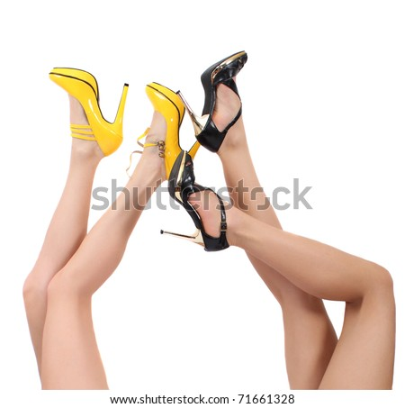 four female feet in shoes - stock photo