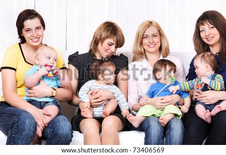Four female friends together with adorable kids - stock photo