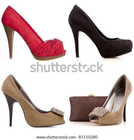 Four female high-heeled shoes isolated on white background. - stock photo