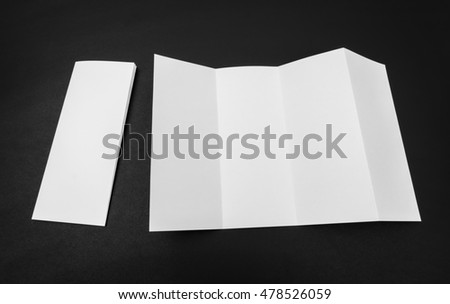Four - fold white template paper on black background