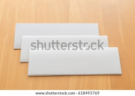 Four fold white template paper on wood background