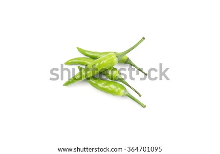 Four fresh green chillies isolated on white. View from top - stock photo
