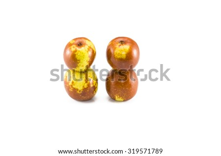 Four fresh jujubes on the white background