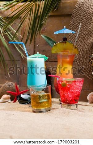 Four Fresh tropical cocktail on beautiful sunny beach - stock photo