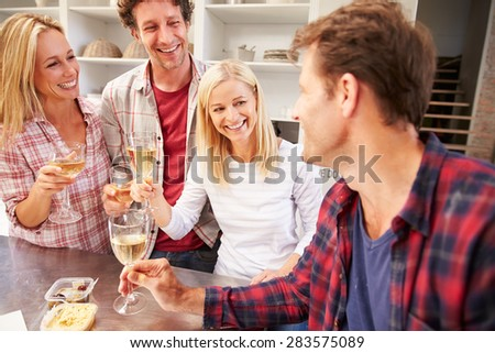 Four friends celebrating at home - stock photo