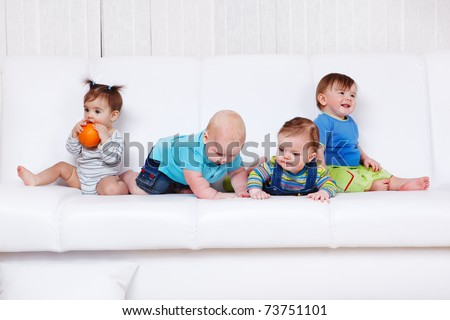 Four friends having leisure time on the sofa - stock photo