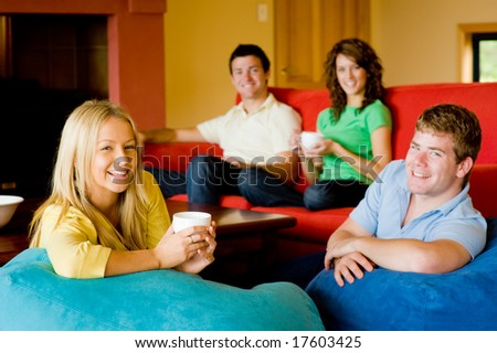 Four friends sitting at home