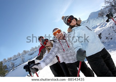 Four friends skiing - stock photo