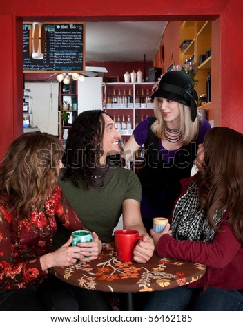 Four friends together at a coffee house - stock photo