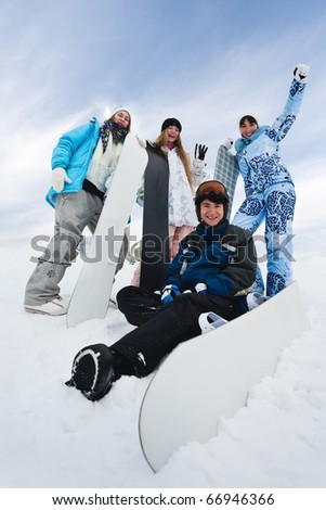 Four fun snowborders in mouintain - stock photo