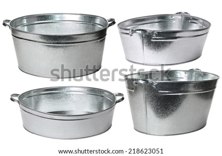 Four galvanized wash basin isolated on white background - stock photo