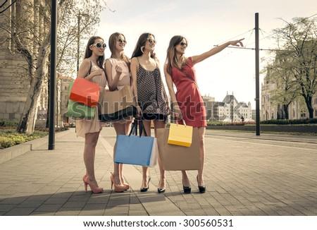 Four girls doing shopping - stock photo