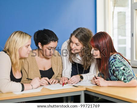 Four girls groupwork in the classroom - stock photo