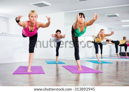 Four girls practicing yoga, Yoga-Virabhadrasana III /Warrior Pose III