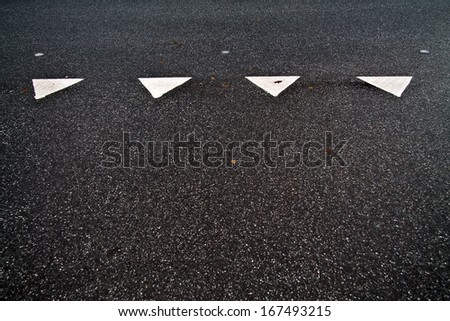 Four give way triangles on street