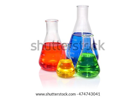 Four Glass Flasks Filled with Colorful Liquids
