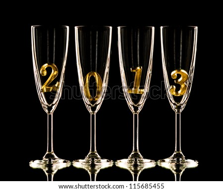 four glass goblet for champagne with  numeral 2013 on  black background,    New Year concept photo - stock photo