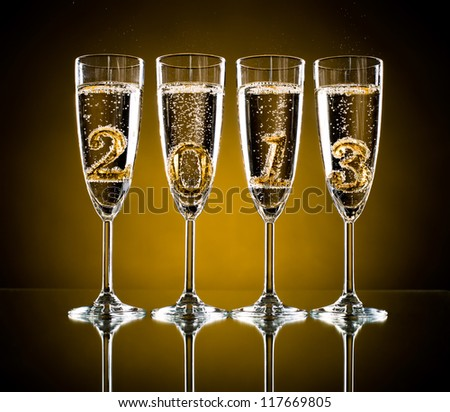 four glass goblet with champagne and  numeral 2013,  beautiful celebrations  New Year concept photo - stock photo