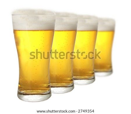 Four glasses of beer against white background