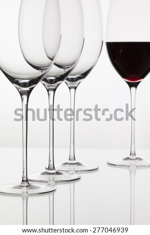 Four  glasses  of  wine and on the white background - stock photo