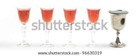 Four glasses of wine and one silver cup for Passover seder.Isolated - stock photo