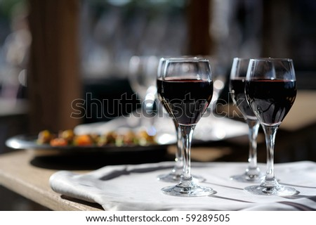 Four glasses with red wine on a sun - stock photo