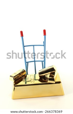 four gold bars on a hand truck on a light background - stock photo