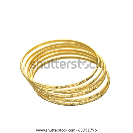 Four golden bracelets stacked together. - stock photo
