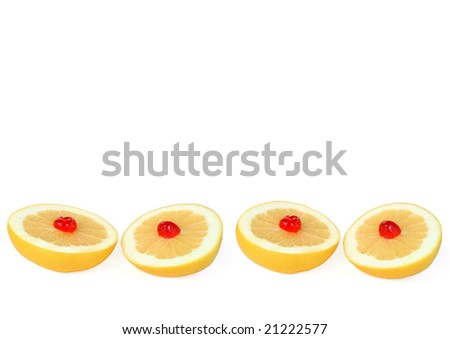 Four grapefruit halves with decorative cherries, isolated over white background.