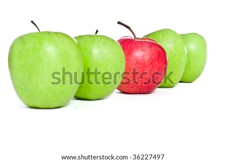 four green apples with one red apple isolated on white background - stock photo