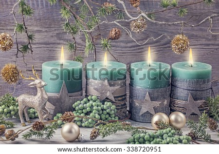 Four green christmas candle for advent - stock photo