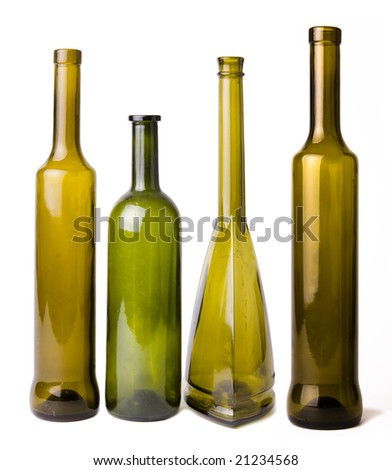 four  green different empty bottles in row - stock photo