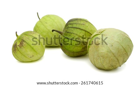 four green tomatoes on white background