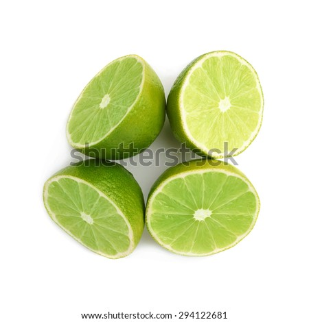 Four halves of a lime fruit isolated over the white background, top view - stock photo