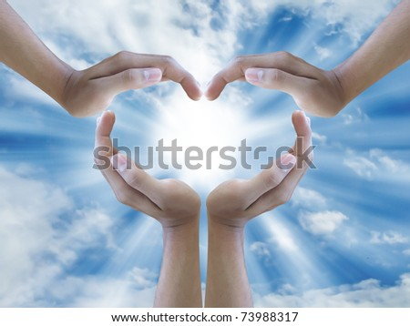 four hand make sign heart around the  sun - stock photo