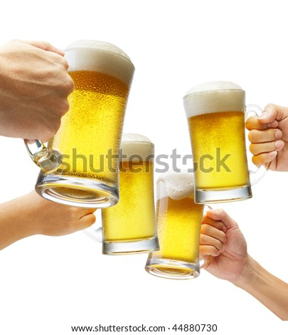 four hands holding beers making a toast - stock photo
