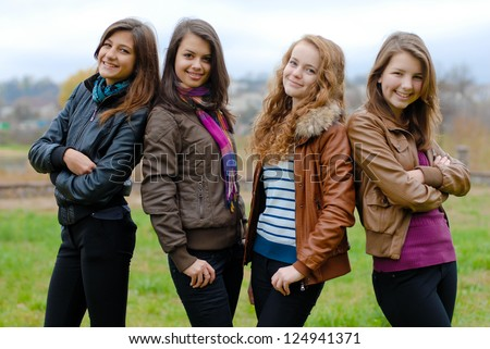 Four happy teenage girls friends - stock photo