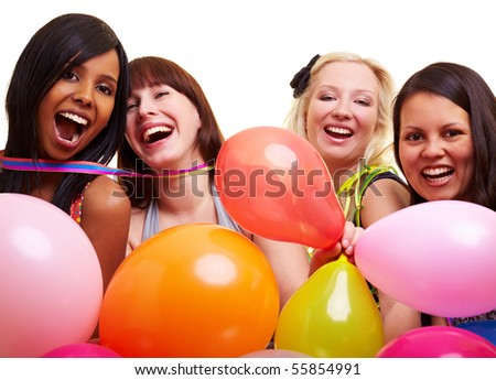 Four happy young women with many colorful balloons - stock photo