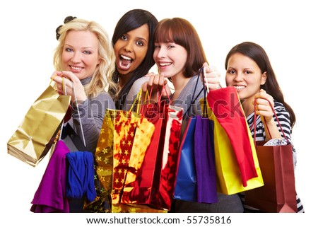 Four happy young women with many shopping bags