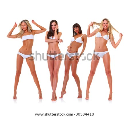 Four harmonous suntanned young women in full growth, in white underwear, isolated on a white background, please see some of my other parts of a images - stock photo