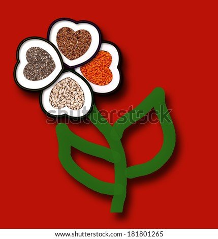 Four hearts filled with grains and seeds (chia, flax, lentils, sunflower) in the shape of clover. Concept for healthy and happy life. - stock photo