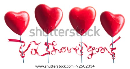 four hearts wrapped with ribbon - stock photo