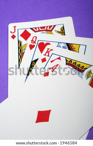 Four High Ranking cards on a purple background - stock photo