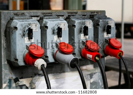 four high voltage electrical connectors - stock photo