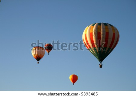 Four hot air balloons - early morning - stock photo