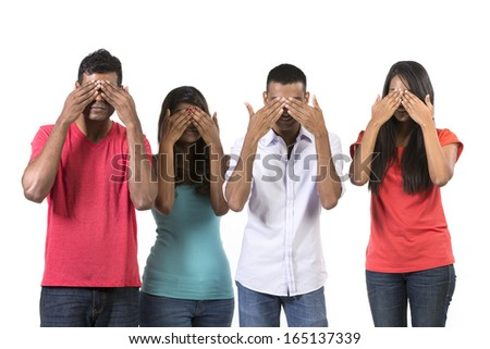 "Four Indian people with their hands over their eyes. ""See no Evil"" concept. Isolated on white.  - stock photo"