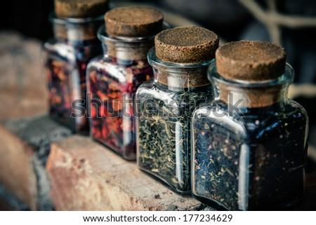 Four jars of different leaf teas - stock photo